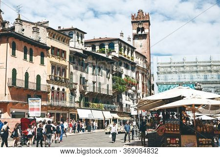 Italy, Verona, June 01, 2019: City Street. Locals And Tourists Walk Or Walk Along A City Street. The