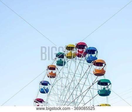 Ferris Wheel On A Blue Sky, Colored Ferris Wheel In The Park