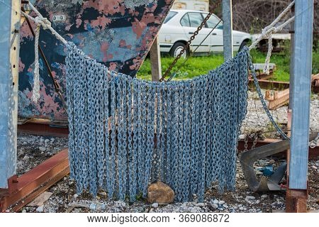 Hanging Anchor Chain In Winter Storage At The Shipyard.