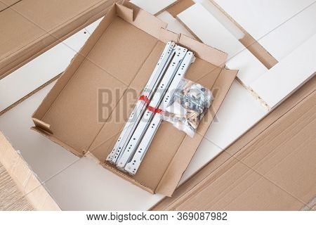 Set Of Spare Parts For Assembling Modern Furniture Eccentric Couplers And Roller Guides, Box With Fu