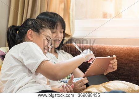 School Kid, Girl Children Studying Online At Home In Group Via  Internet E-learning, Reading E-book