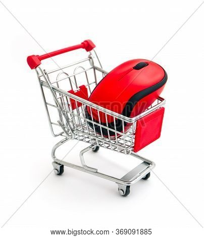 Red Computer Wireless Mouse In Shopping Trolley Isolated On White.