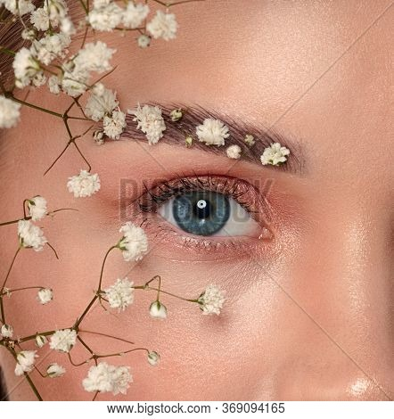 Beautiful Woman Portrait With Fresh Daily Make-up Blonde Hair And Healthy Skin. Flowers Face Brows.