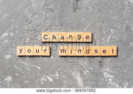 Change Your Mindset Word Written On Wood Block. Change Your Mindset Text On Cement Table For Your De