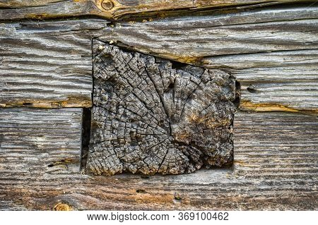 An Exterior Wall Detail Of A Very Old Handmade Wooden House In The Village. The End Of The Log In A