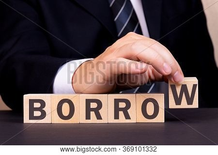 Man Made Word Borrow With Wooden Blocks. Business Concept.