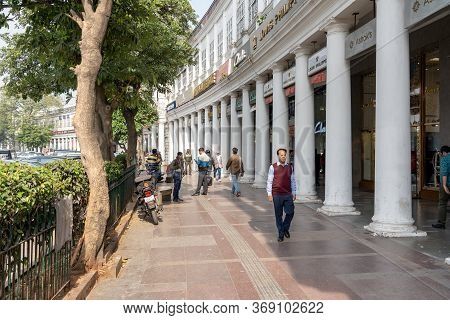 New Delhi, India - December 4, 2019: People And Classic Facades Of Columns At Connaught Place.