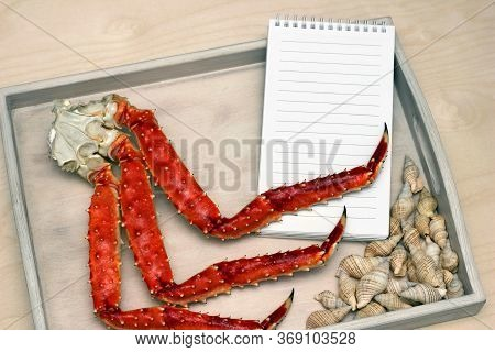 Legs Of A Boiled Crab On A Wooden Tray . Clean Sheet For The Menu. Copy Space.
