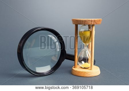 Magnifying Glass And Hourglass. Limited Search Concept. Find Free Time. Subscription, Paid Plan. See