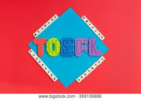 Word Toefl And Words Reading, Listening, Writing, Speaking On Color Background. Usa Exam. Speaking E