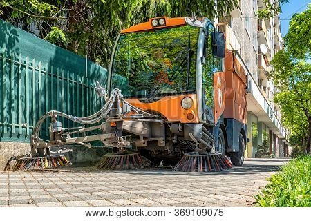 Ruzomberok, Slovakia - May 22, 2020 - Street Cleaner Vehicle, Road Sweeper Cleaning On The Pavement