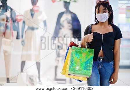 African American Woman Wearing Face Protective Medical Mask For Protection From Virus Disease With S