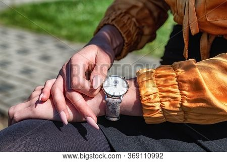 Close Up View On White Women's Wrist Watch On The Girl's Hand With Gel Nails.