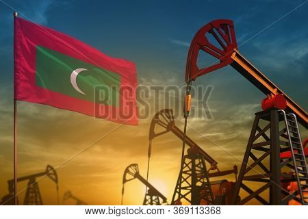 Maldives Oil Industry Concept, Industrial Illustration. Fluttering Maldives Flag And Oil Wells On Th