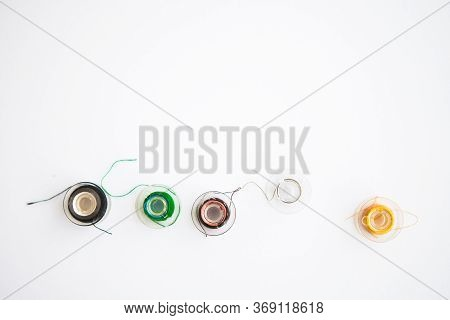 Sewing Tools On White Background With Copy Space For Your Text