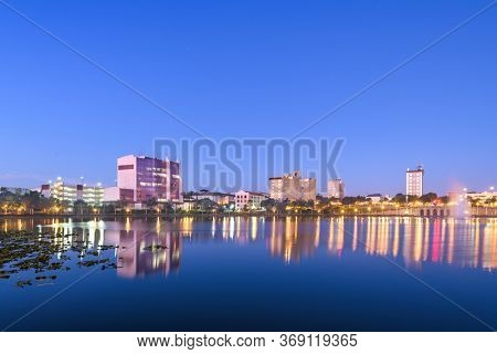 Lakeland, Florida, USA downtown cityscape on the lake at twilight.