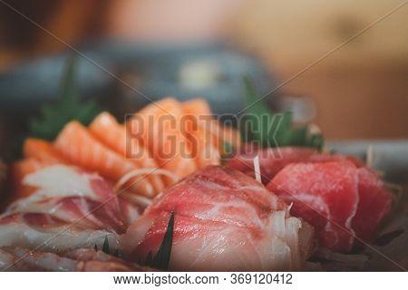 Fresh Raw Salmon Fish Sashimi Is Sliced In Japanese Cuisine. Assorted Fresh Sashimi And Japanese Foo