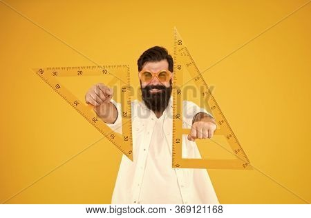 For Drawing, Draughting And Design. Hipster Holding Drawing Instruments On Yellow Background. Archit