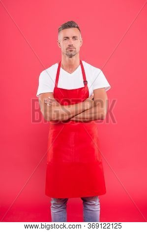 Handsome Waiter In Red Apron. Successful Small Business Owner. Serious Confident Mature Waiter Entre