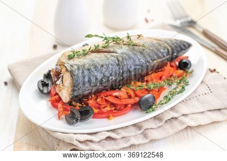 Baked Fish Mackerel With Vegetables, Sweet Pepper And Black Olives And Herbs. Ketogenic Food. Ready