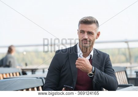 Looking Amazing As Man. Business Man Sit In Outdoor Cafe. Handsome Man Wear Business Casual. Profess