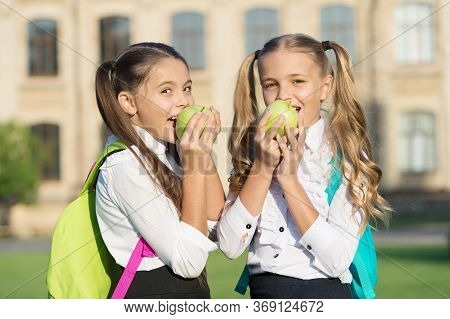 Ensure Healthy Daily Balance. Happy Girls Eat Apples Outdoors. School Snack. Healthy Diet. Vegetaria