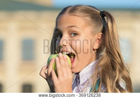 Eat For Health. Happy Child Bite Apple Outdoors. Natural Dieting. Dental Health. Oral Hygiene. Denta
