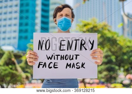 Man In Medical Mask Prevents Coronavirus Disease Holds A Poster No Entry Without Face Mask Hand Writ