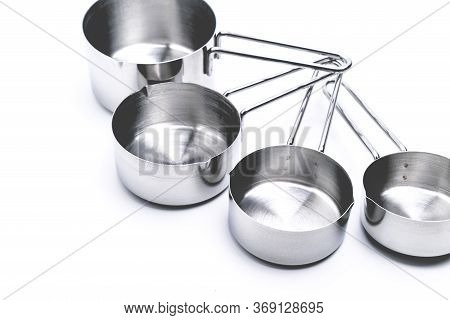 Measuring Cups On White Table