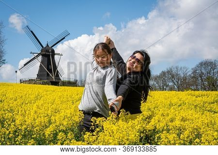 An Asian Mother In Her 50s And Her 11 Years Old Daugher Enjoys Bonding And Outing In A Field With Ye