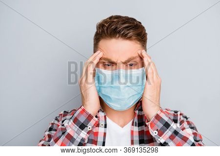 Portrait Of Ill Sick Young Man In Shirt Wear Medical Safety Face Mask, Touching His Head Feeling Pai