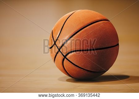 Basketball On Basketball Parquet Floor. Close-up Image. Basketball Sports Background