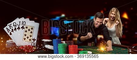 Man And Woman Happy About Win. Posing Standing At Playing Table On Colorful Background. Winning Comb