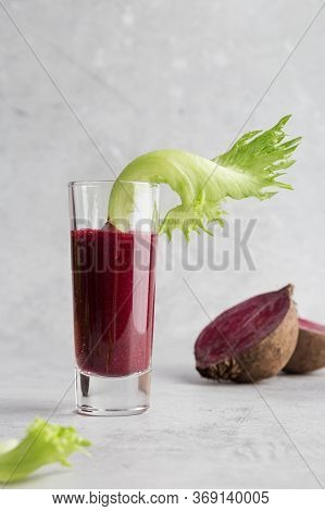 Glass With Beetroot Smoothie With Green Salad As Garnish. Whole Beetroot Behind. Concept Of Healthy
