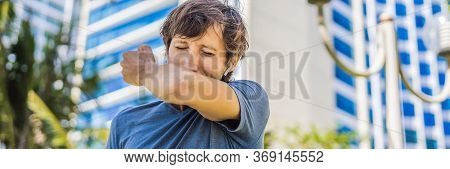 How To Sneeze Correctly. Man Sneezes On The Elbow. Concept Of The Spread Of The Virus Banner, Long F