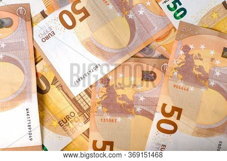 50 Euro Banknotes In Pattern Over White Background. Euro Banknote As Part Of The Economic And Tradin