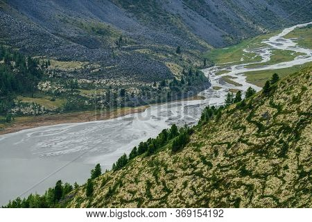 Awesome Aerial View To Beautiful Valley With Mountains Lake And Giant Textured Hillside. Atmospheric