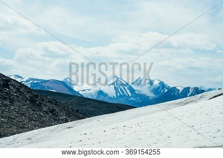 Beautiful Alpine View To Awesome Huge Mountains With Big Glaciers Behind Snowy Mountainside Under Cl