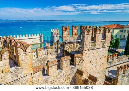 Stone Defense Walls With Merlons And Brick Tower Building Of Scaligero Castle Castello Di Sirmione M