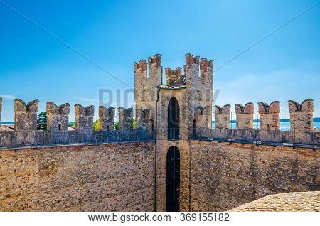 Tower And Stone Defense Wall With Swallowtail Merlons Of Scaligero Castle Castello Di Sirmione Medie