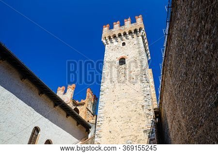 Tower And Stone Walls With Merlons Of Scaligero Castle Castello Di Sirmione Medieval Fortress, Sirmi