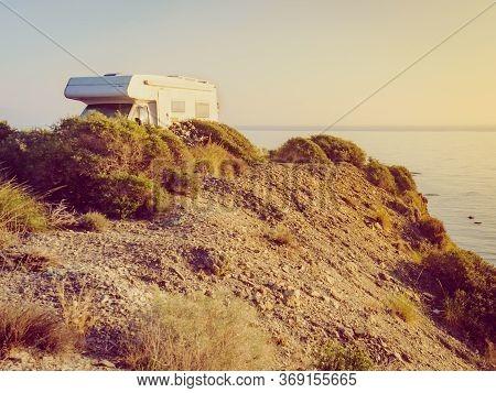 Camper Car Camping On Cliff Above Cabezo Negro Beach, Spanish Landscape Along Almeria Coast. Traveli