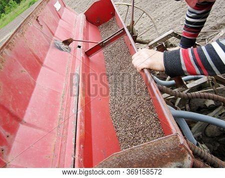 Plowed Field By Tractor In Brown Soil On Open Countryside Nature. Tractor In Plowed Field, Soil To G