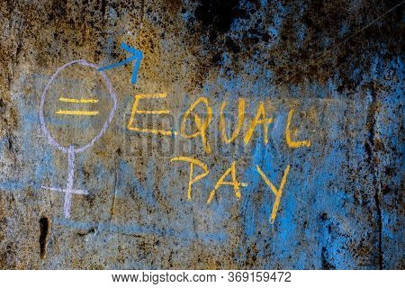 Creative Representation Of Equal Pay With A Bigender Symbol Over A Rough Wall With Written Equal Pay