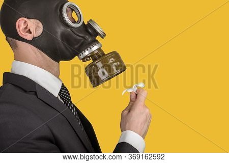 Close Up Portrait Of Man In A Protective Gas Mask With Flower