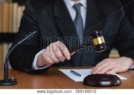 Law And Order. Judge Man With Documents And Gavel On The Table. Court Listens To Condemn And Punish.
