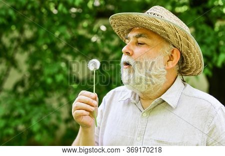 Peacefulness. Tranquility And Serenity. Harmony Of Soul. Elderly Man In Straw Summer Hat. Happy And