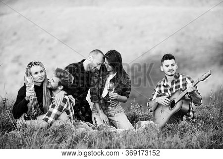 Carefree Camping. Hiking Adventure. Happy Men And Girls Friends With Guitar. Friendship. Romantic Pi
