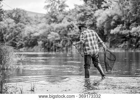 Happiness Is Rod In Your Hand. Senior Man Catching Fish. Mature Man Fishing. Retired Fisherman. Fish