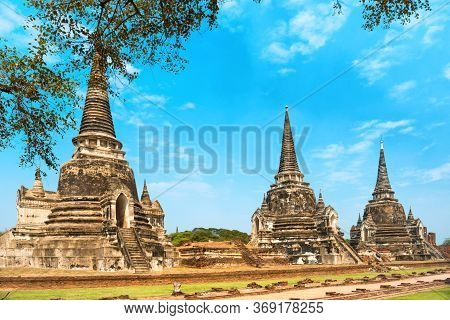 Historical Architecture Of Thailand - Ruins Of Old Siam Capital Ayutthaya. View To Three White Chedi